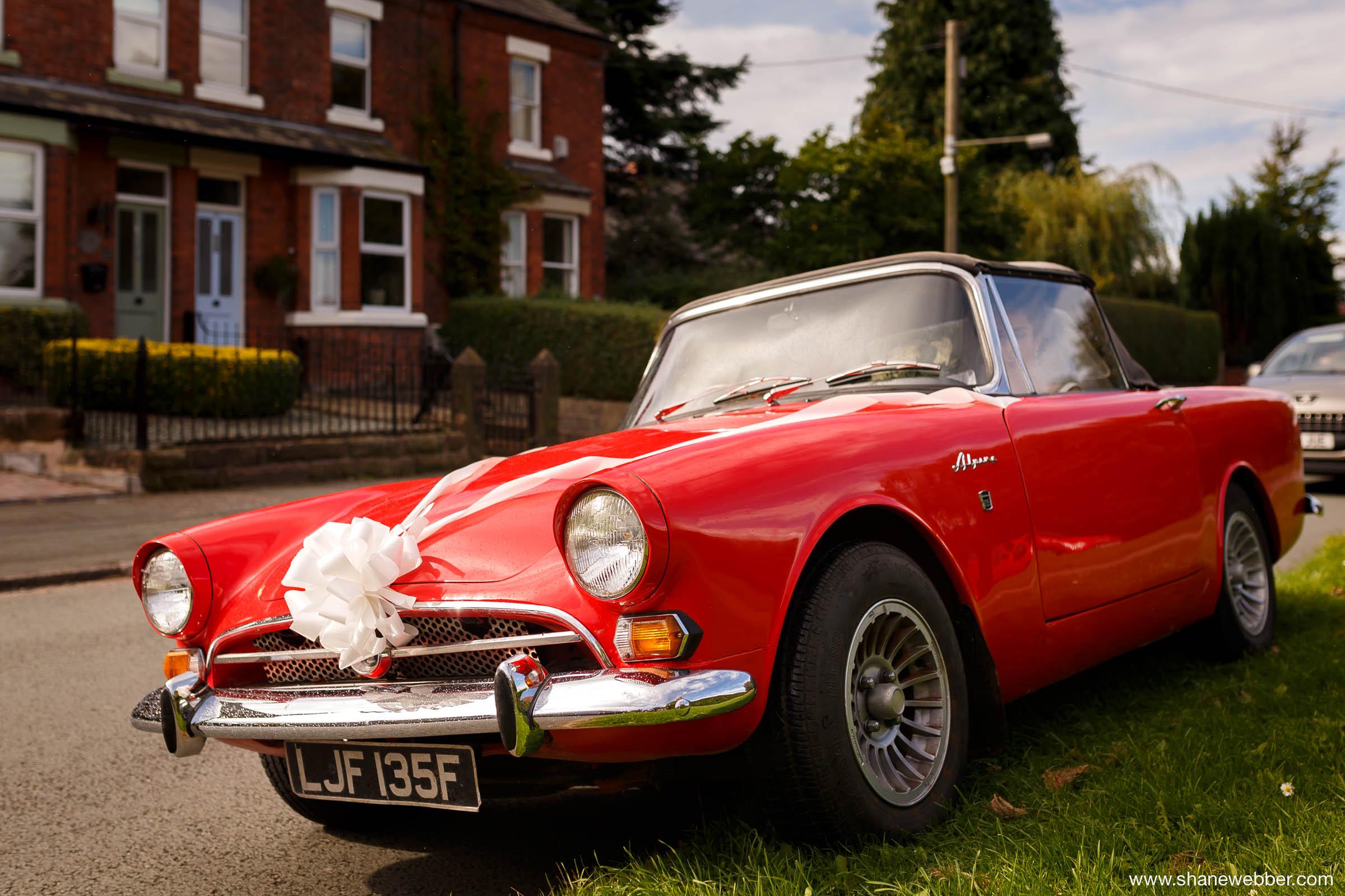Bright red vintage wedding car