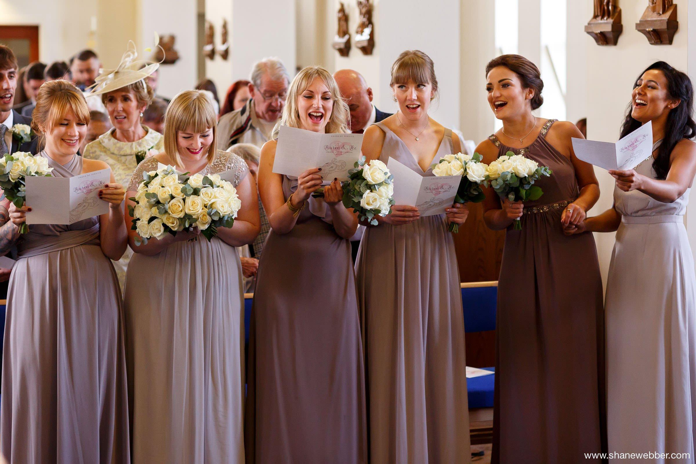 Bridesmaids singing at church hymns