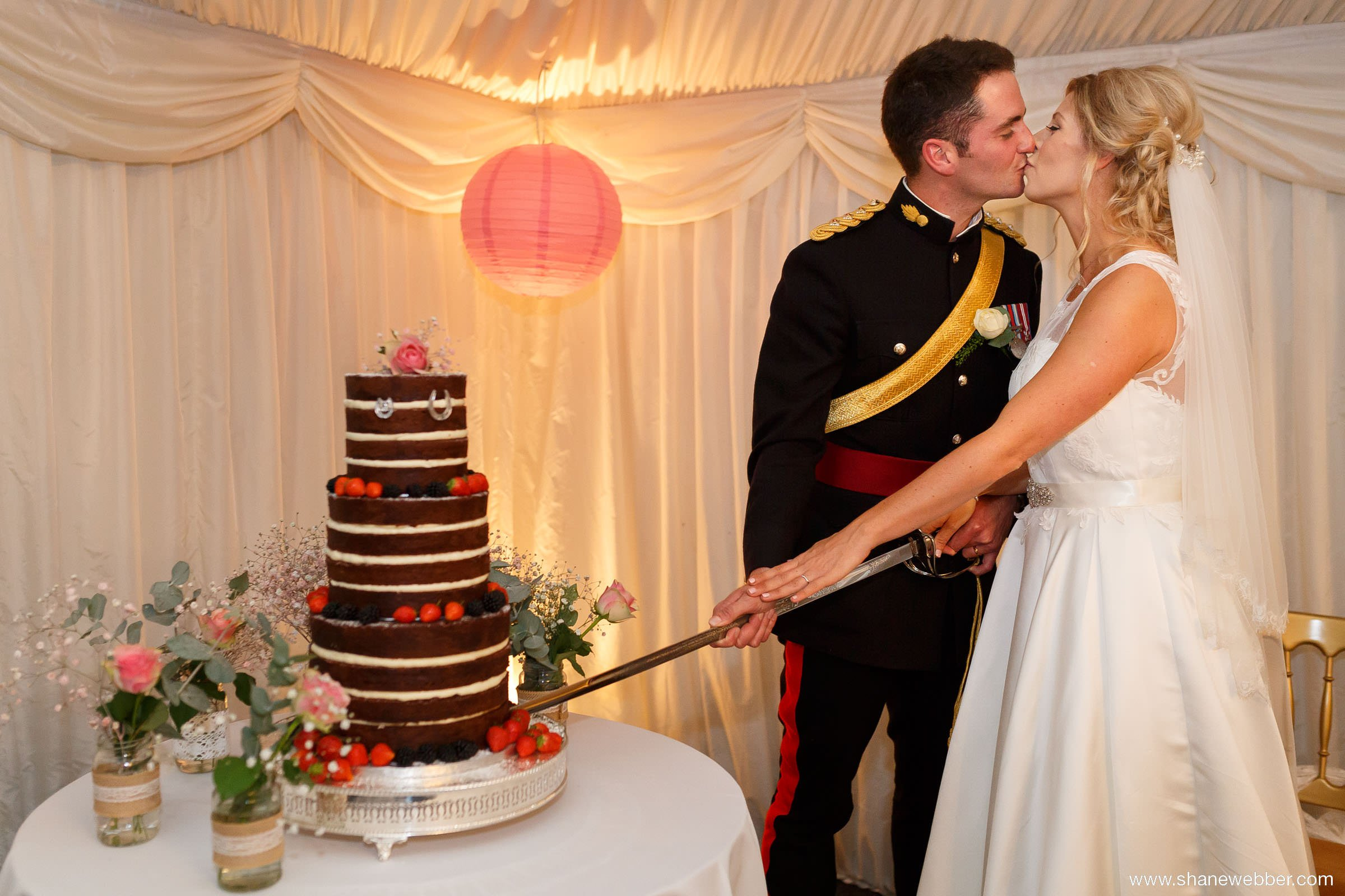 Cutting wedding cake with a sword