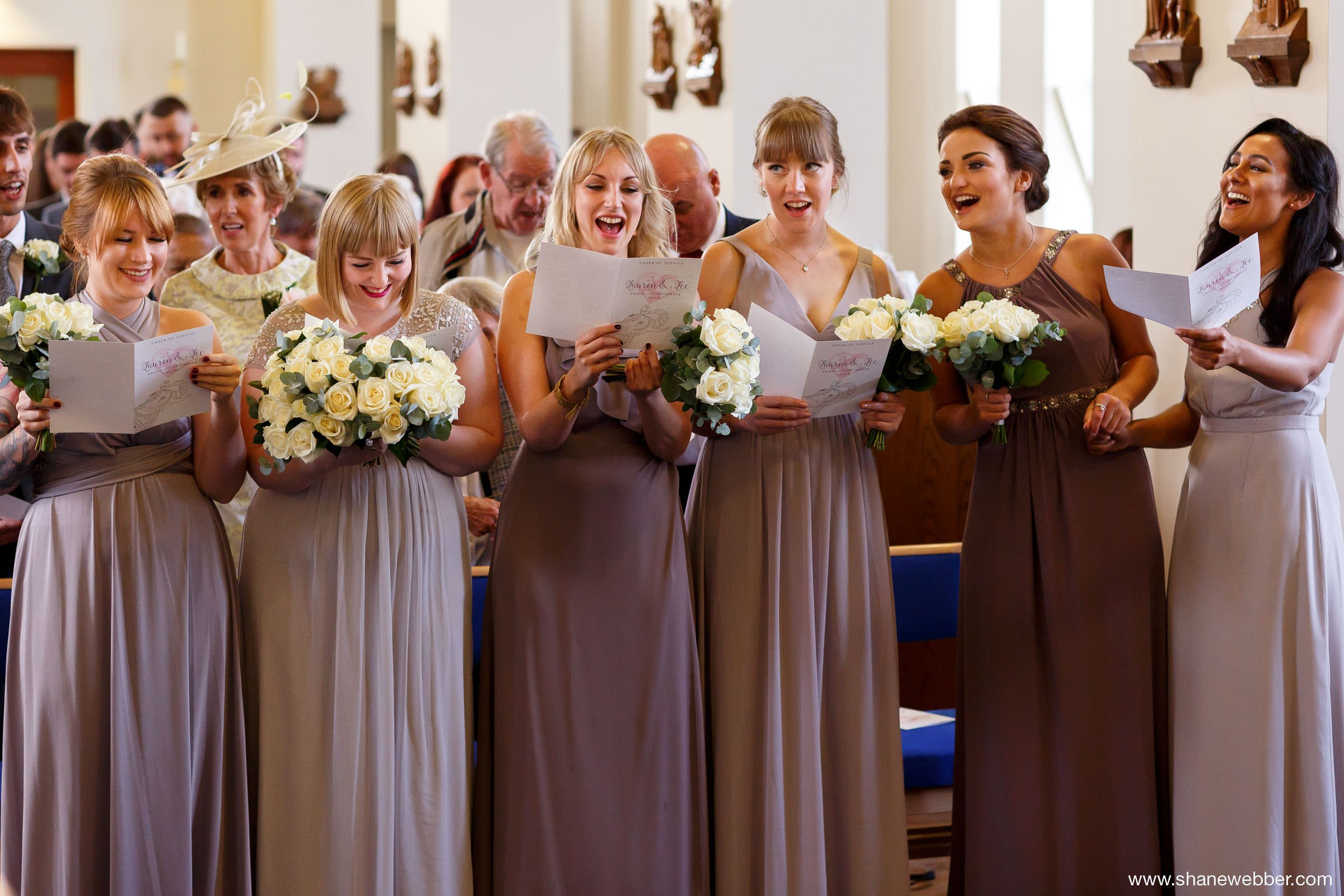 Bridesmaids singing at church hymns