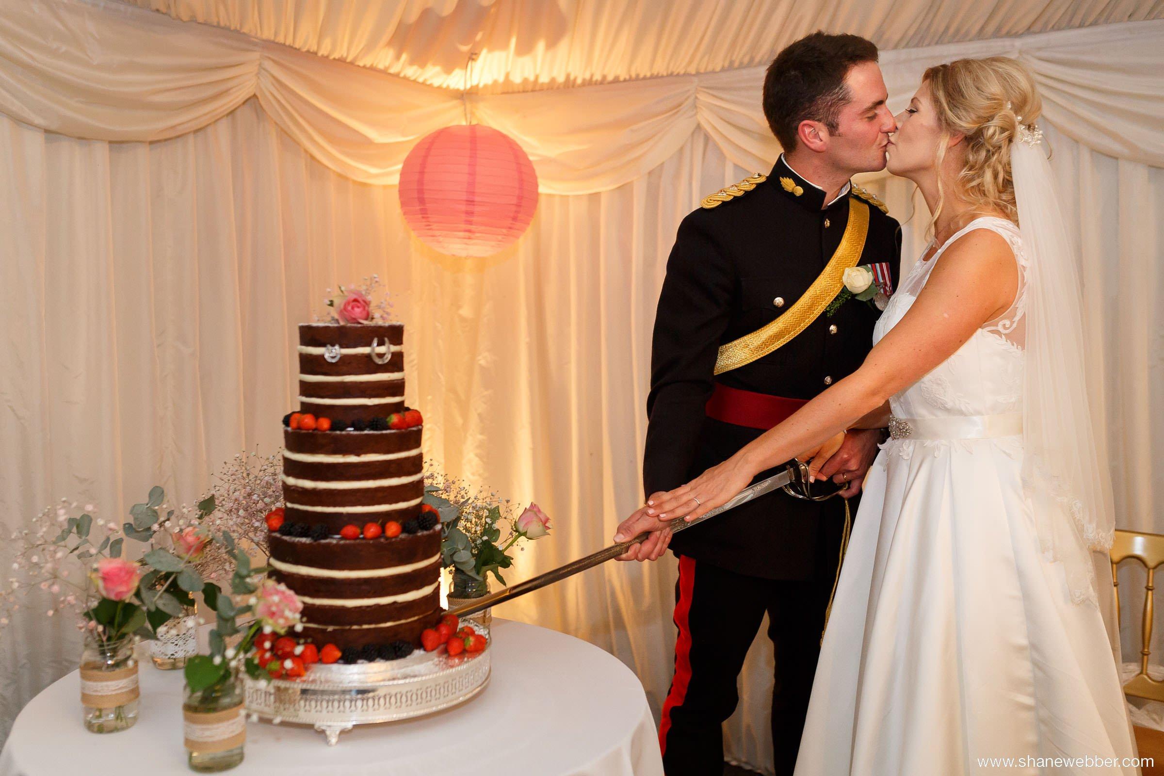 Cutting wedding cake with a sword